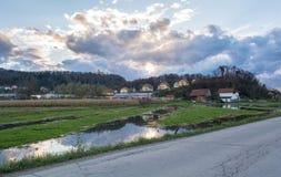 Затопленная земля перед домами Стоковые Фотографии RF