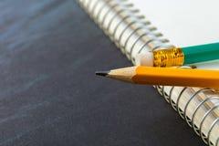 Заточенный карандаш и тетрадь Стоковые Фотографии RF
