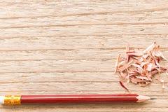 Заточите карандаш на деревянной доске Стоковая Фотография RF