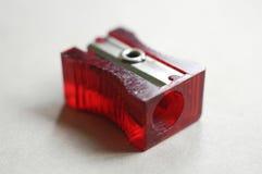 заточник красного цвета карандаша Стоковое фото RF