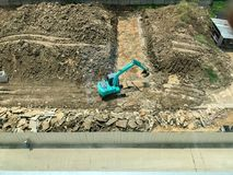 Затяжелитель Backhoe в строительной площадке стоковое изображение rf