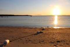 Заходы солнца пляжа Стоковые Изображения