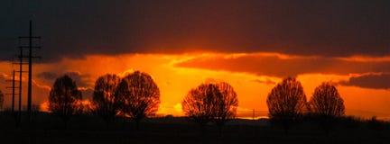 Заходящее солнце в восточной Фландрии стоковое фото