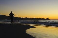 заход солнца берега бегунка la jolla Стоковое Фото