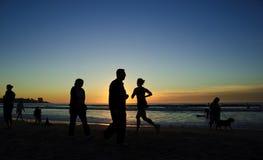 заход солнца берега бегунка la jolla Стоковое Изображение RF