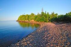 заход солнца берега озера Стоковые Изображения