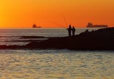 заход солнца берега carcavelos Стоковое Фото