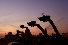 заход солнца бульдозеров Стоковая Фотография