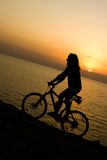 заход солнца велосипедиста Стоковое фото RF