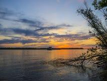 Заход солнца воды Стоковые Фото