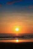 заход солнца восхода солнца берега тропический стоковое изображение