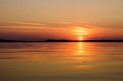Заход солнца в воде Стоковое фото RF