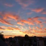 Заход солнца в городе Стоковая Фотография