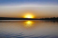 Заход солнца в заливе Стоковое Изображение