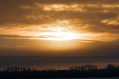 Заход солнца в небе стоковое фото rf