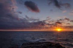 Заход солнца в океане Стоковые Фото