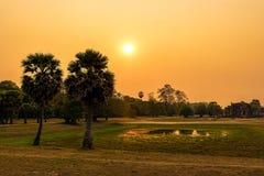 Заход солнца в парке Angkor археологическом в шве ужинает Камбоджу стоковая фотография rf