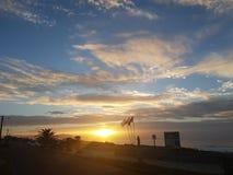 Заход солнца в пляже Стоковые Фото
