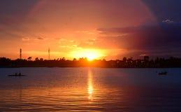 Заход солнца в реке Стоковая Фотография