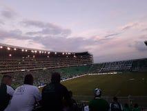 Заход солнца в стадионе стоковые изображения