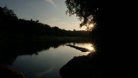 Заход солнца в silhoute Стоковые Фотографии RF