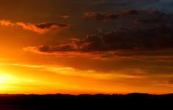 заход солнца гор предпосылок Стоковое фото RF