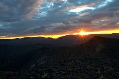 заход солнца гор Стоковые Фото