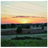 Заход солнца далеко Стоковые Изображения