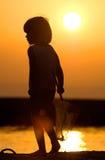 заход солнца девушки рыболовства Стоковое Фото