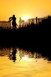 заход солнца девушки Стоковое фото RF