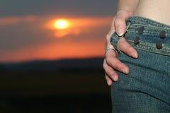 заход солнца джинсыов Стоковая Фотография RF