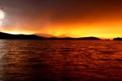 заход солнца дождя стоковое изображение rf