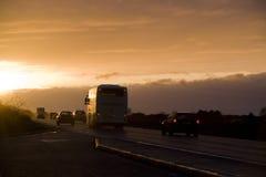 заход солнца дороги кареты стоковая фотография
