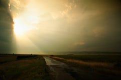 заход солнца дороги к Стоковые Изображения