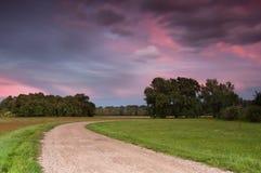 заход солнца дороги поля Стоковое Фото
