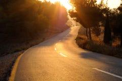 заход солнца дороги стоковое изображение