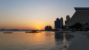 Заход солнца Дохи стоковая фотография