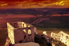 заход солнца замока spissky стоковая фотография rf