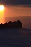 заход солнца зернохранилищ Стоковое Фото