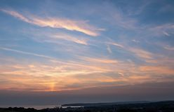Заход солнца и высокий залив Seaford cloudsover стоковое фото rf