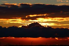 Заход солнца и красное небо Стоковые Фото