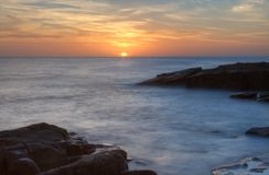 Заход солнца и утесы Стоковое Изображение