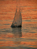 заход солнца камня выплеска моря Стоковые Фото