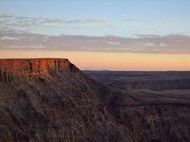 Заход солнца каньона реки рыб Стоковые Изображения RF