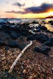 Заход солнца Кауаи Гаваи на пляже Стоковое Изображение RF