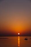 заход солнца Кипра шлюпки пляжа стоковое фото rf