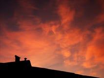 заход солнца крыши Стоковое Изображение