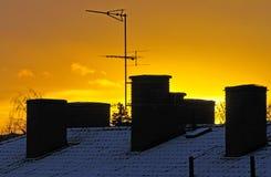заход солнца крыши Стоковые Изображения
