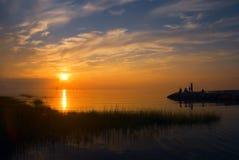 заход солнца людей пляжа Стоковая Фотография RF
