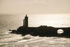 заход солнца маяка стоковое фото